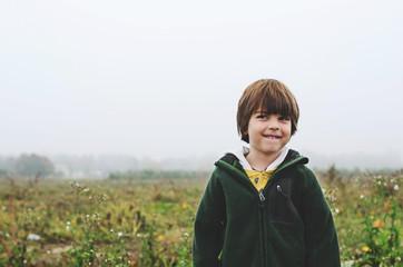 Boy in a Pumpkin Patch