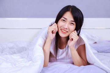 portrait beautiful woman on bed in bedroom