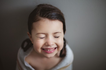 smiling girl wrapped in towel after bath