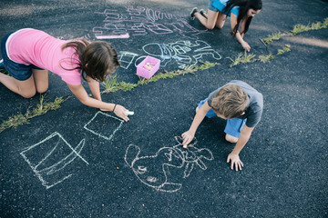 Recess: School Students Being Creaive With Chalk Drawing