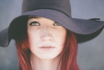 young woman with classic hat