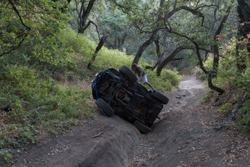 Man on rolled over off road vehicle
