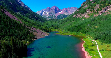 Jagged Mountain Peak Framed By Green Valley With Lake - Maroon Bells, Colorado, USA