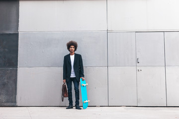Modern afro black businessman standing on a urban space.