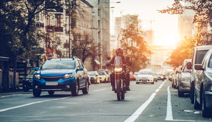 Motorcycle and cars on street Fototapete
