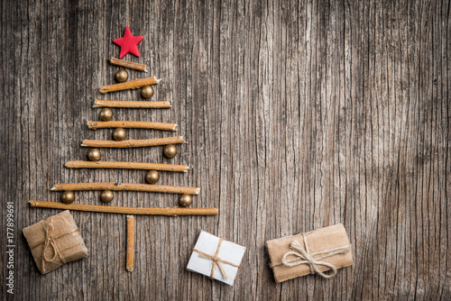 Christmas Tree Made Of Branches And Golden Pearls On Rustic Wooden Background With Space For Text