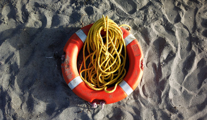 safety belt and rope on the sand beach