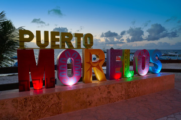 Puerto Morelos word sign in sunset Mexico