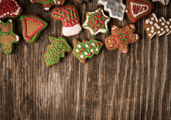 Gingerbread cookies over wooden background