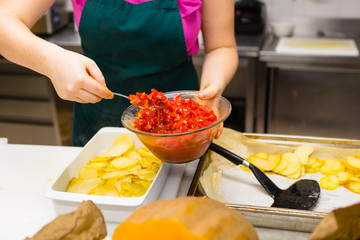 Preparing Tomatoes and Potatoes in a Professional Kitchen
