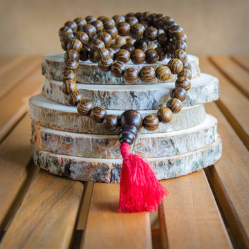 Close up of wood mala beads, traditionally used in prayer and meditation. Essential accessory for mindfulness or practice yoga.