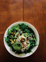 Bowl of Green Salad on Brown Wooden Table Overhead