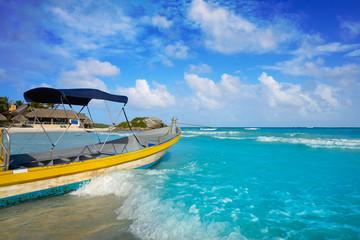Tulum Caribbean beach boat in Riviera Maya