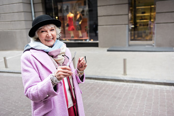 Happy mature woman walking in city with enjoyment