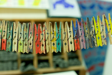 row of colorful painted clothespins
