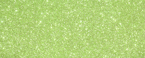 background Green glittered with glittering lights and reflection