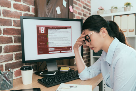 woman finding computer getting virus attack