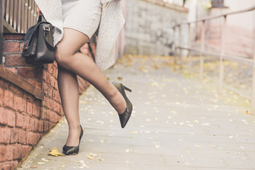 Woman legs wearing black high heel shoes