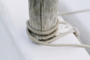 Rope tied around a wooden post