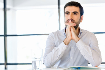 Pensive businessman at office