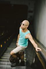 Young man in Washington DC on the metro escalator