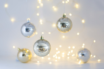 Beautiful Gold and Silver Christmas ornaments and Christmas light background.