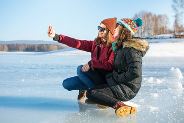 Girl taking selfie on a frozen lake