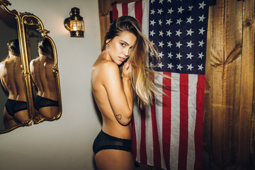 Topless woman at USA flag