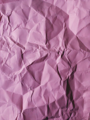 Close up of crumpled piece of colorful construction paper