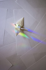 Solo Japanese origami crane in coloful prism light