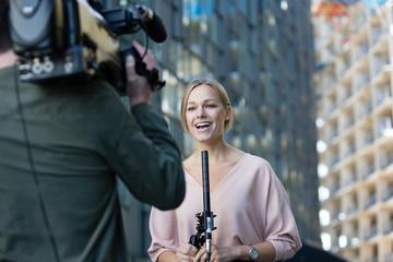 Female news presenter talking to camera