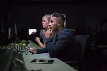 Operators in a control room at a television studio