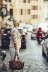 Elegant Blonde Businesswoman Crossing the Street