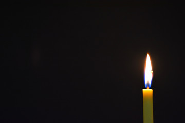 Candle light with dark background.