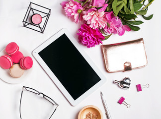 Stylish feminine accessories, peonies and tablet with blank screen