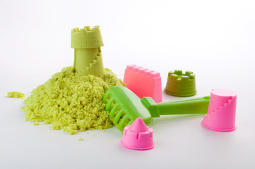 Castle made of kinetic sand on white background