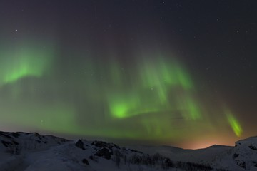Snow covered the hills and in the sky stars, clouds and northern lights.