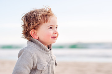 Toddler at the beach in winter