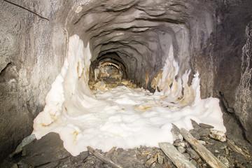Underground mine shaft iron copper gold ore tunnel gallery with white mud
