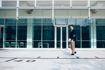 Young business man walking out of the office