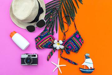 Summer Fashion woman swimsuit Bikini, camera, fish star, sunblock, sun glasses, hat. Travel in the holiday wood blue background.  Summer Concept.