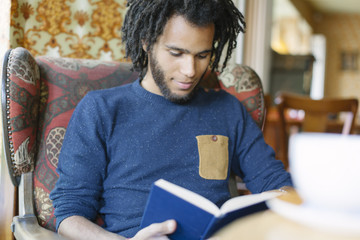 Portrait of an afro black man reading a book