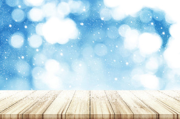 Christmas and New year background. Wooden table with abstract winter snowfall. Can be used product display.