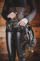 Close up shot of the Boho style leather bag on the girls body