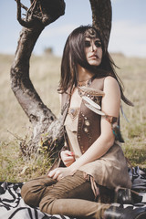 Beauty shot of wild looking girl in Native American style