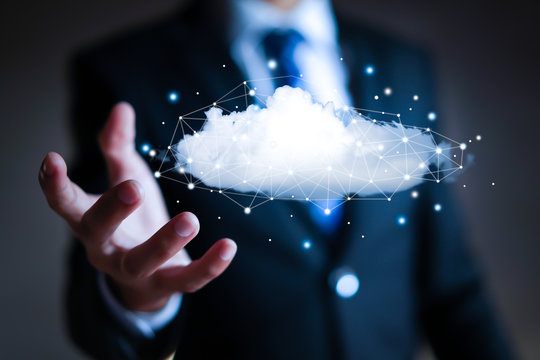 Cloud computing concept - connect to cloud. Businessman or information technologist.