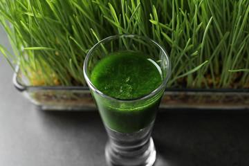 Shot of healthy wheat grass juice, closeup