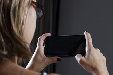 Coast woman using cellphone