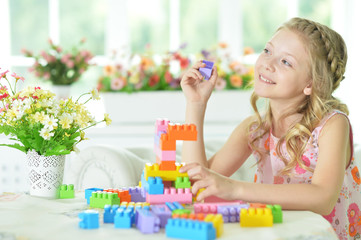 little girl with colorful plastic blocks