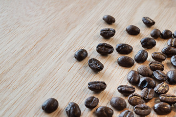 close up of Coffee beans on wood background, selective focus (detailed close-up shot)